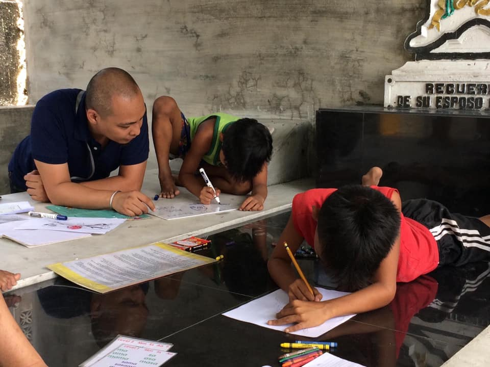 Ang Galing Basic Literacy Tutorial for children at Manila North Cemetery